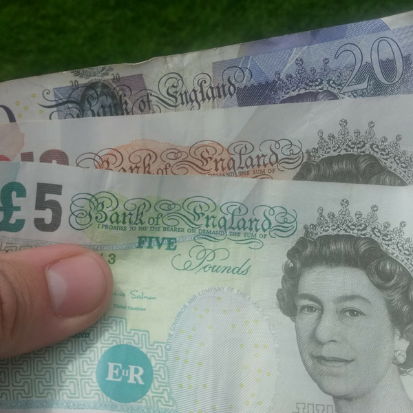 Money / banknotes (pounds sterling) in hand